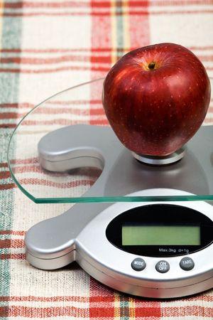 electronic balance: fresh apple placed on a kitchen balance
