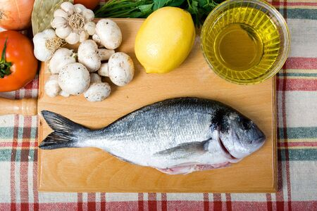 sea bream: sea bream and food ingredients on a table