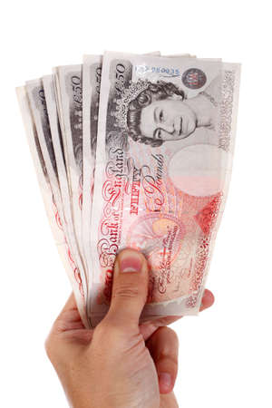 money pounds: fifty pound notes in  hand Stock Photo