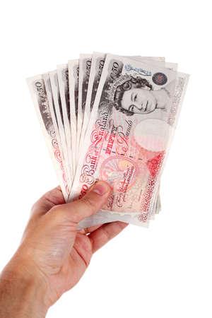 libra esterlina: cincuenta libras notas en la mano