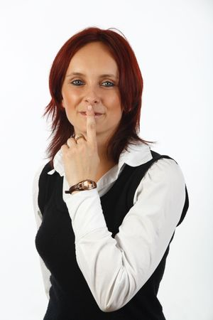 shush: Young businesswoman gesturing shush  on off white background