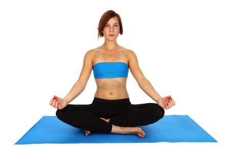 young woman doing yoga on a blue mat Stock Photo - 5496879