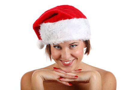 wearing santa hat: young woman wearing santa hat and smiling