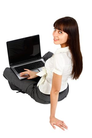 young woman using laptop pictured from rear view photo