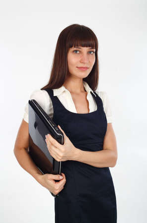underarm: young businesswoman holding her notebook computer underarm Stock Photo