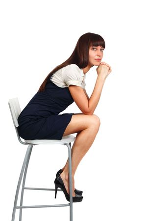 young beautiful businesswoman sitting on a chair studio shot on white photo