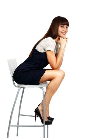 sitting on: young beautiful businesswoman sitting on chair and smiling