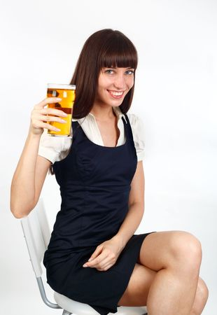 young woman holding a pint of beer and toasting
