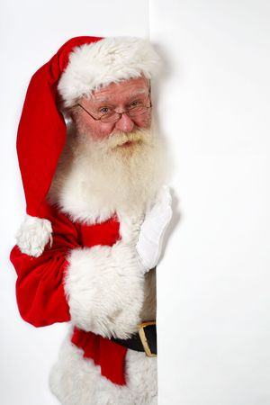 father christmas holding a blank banner