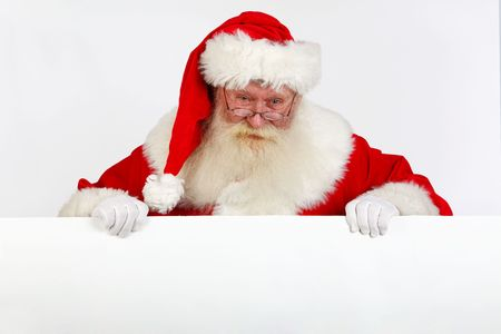 peeking: father christmas holding a blank sign with room for text