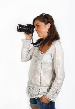 young woman taking a picture with a dslr camera photo