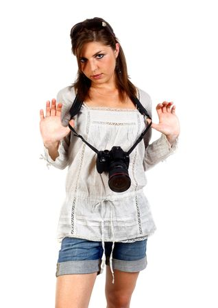 young beautiful woman with a DSLR camera studio shot on white photo
