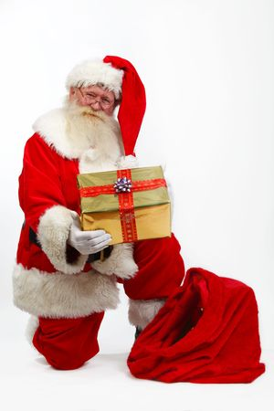 father christmas taking a gift box from his sack photo