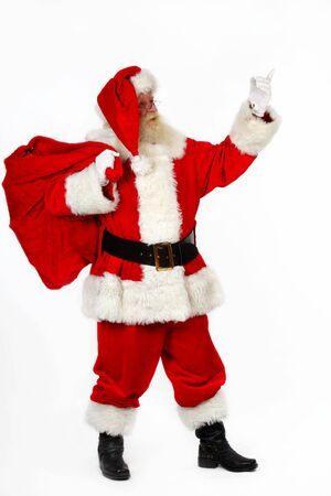 father christmas pointing with his finger as he carries his sack photo