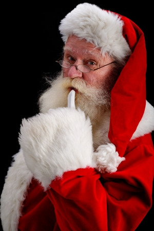 peeking: father christmas gesturing shush