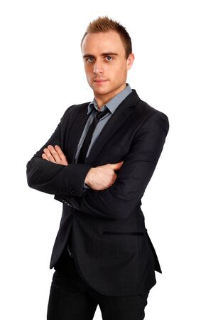 young confident businessman with crossed arms photo