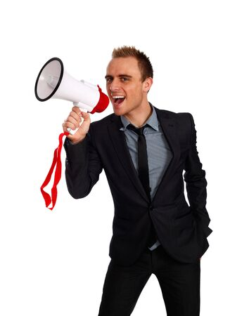 annoucement: young confident businessman making an annoucement with a megaphone
