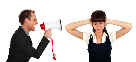 young businessman shooting at  a businesswomans  with a megaphone