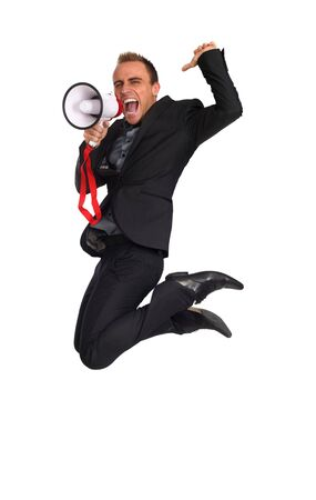 young businessman making announcement with a megaphone as he jumps photo