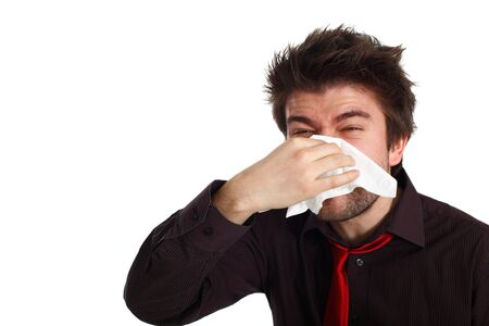young man with cold virus blowing his nose Stock Photo - 6453732