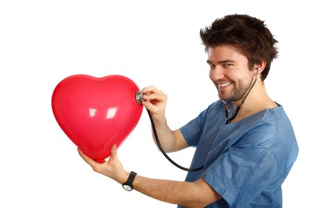 young doctor examining a heart shaped baloong
