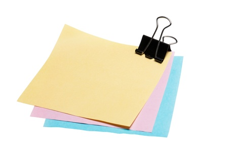 Stock Photo  post-it note paper with binder clip isolated on white background photo