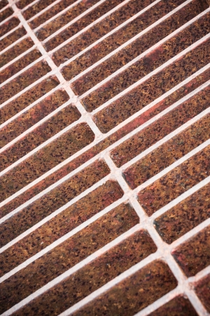 Rust steel grating of Drain cover Stock Photo - 20702172