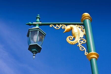 Golden sea horse street lamp with sky