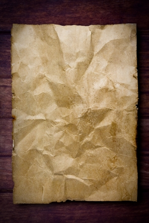 ancient scroll: old paper on brown wood