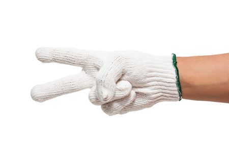 hand in white glove count to two isolated on white  photo