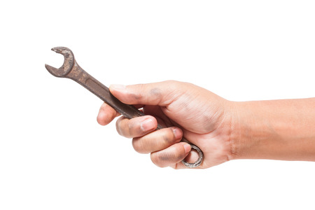 open end wrench: hand holding a spanner isolated on a white background with using path