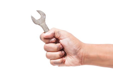 hand holding a spanner isolated on a white background with using path  photo