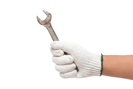 open end wrench: Hand in glove holding a spanner isolated on a white background with using path  Stock Photo