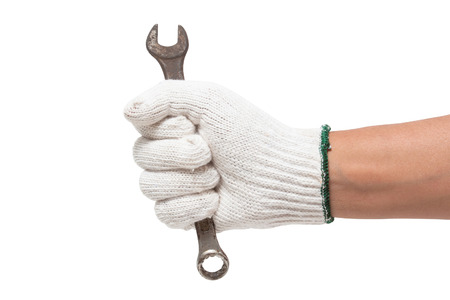 open end wrench: Hand in glove holding a spanner isolated on a white background