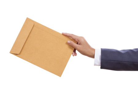 Businessman hand holding brown pack document with using path Zdjęcie Seryjne