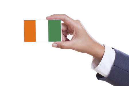 isolation backdrop: Businessman holding a business card with Ivory Coast Flag  Stock Photo