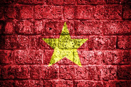 Grunge Vietnam flag on brick wall  photo