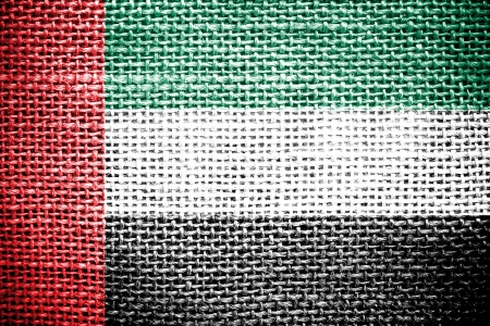 Texture of sackcloth with the image of the United Arab Emirates Flag   photo