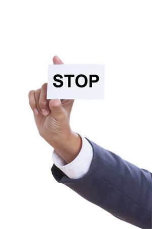 Businessman showing stop sign on white background  Stock Photo - 25296756
