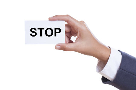 Businessman showing stop sign on white background  Stock Photo - 25296765