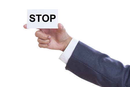 Businessman showing stop sign on white background Stock Photo - 25296837