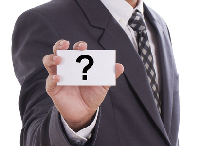 Businessman hand showing someone his business card with Question mark  photo