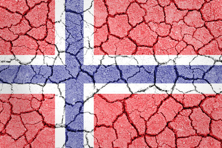 The Norwegian flag painted on cracked ground with vignette  photo