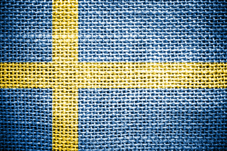 Texture of sackcloth with the image of the Sweden Flag  photo