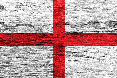 England Flag painted on old wood plank background photo