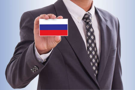 Businessman in suit holding a business card with a Russia Flag photo