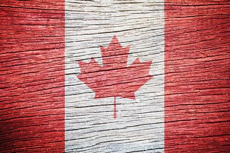 Canada flag on old wood background  photo