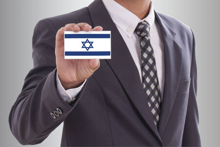 Businessman in suit holding a business card with a Israel Flag  photo