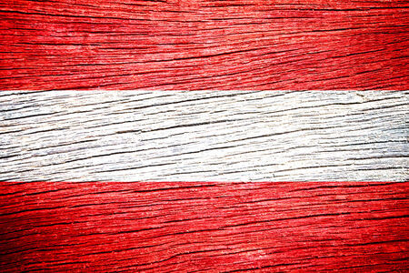 Austria Flag painted on old wood plank background  photo