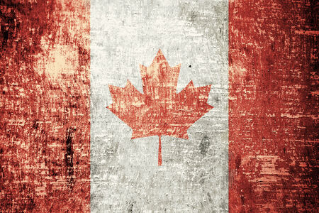 Canada flag on old wood texture background  photo